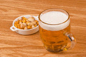 Beer with assorted nuts — Stock Photo