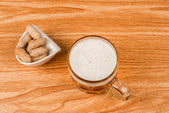 Beer and peanuts high angle — Stock Photo