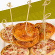 Small pizzas — Stock Photo #26396923
