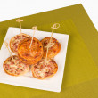 Mini pizzas — Stock Photo #26566079