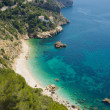 Secluded Mediterranean beach — Stock Photo