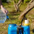 Stock Photo: Filling pesticide sprayer