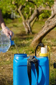 Filling a pesticide sprayer — Stock Photo