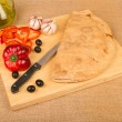 Calzone and ingredients — Stock Photo