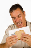 Eating a bill sandwich — 图库照片