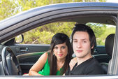 Couple inside car — Stock Photo