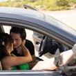 Romance inside a car — Stock Photo