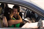 Romance inside a car — 图库照片