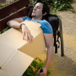 Drunk on park bench — Stock Photo