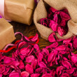Stock Photo: Gifts and petals