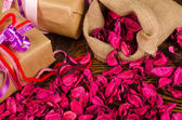 Gifts and petals — Stock Photo