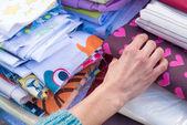 Fabrics on a market stall — Stock Photo