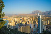 First  sunrays on Benidorm — Stock Photo