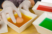 Dipping Easter eggs — Stockfoto