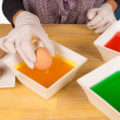 Dyeing Easter eggs — Stock Photo #44561301