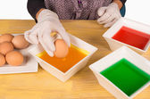 Dyeing Easter eggs — Stock Photo