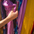 Female hands choosing clothes — Stock Photo #46178367