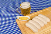 Beer and sausages — Stockfoto