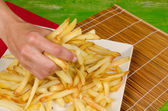 Grabbing french fries — Stock Photo