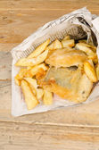 Fish and chips in newspaper — Stock Photo
