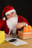 Santa cigarette break — Stock Photo