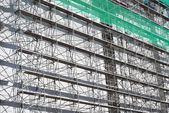 Scaffolding with Green Net — Stock Photo