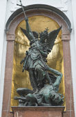 Saint Michael defeats Satan — Stock Photo