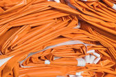 Folded Tarpaulin in Orange — Stock Photo