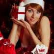 Woman santa helper with gift box — Stock Photo #12584906