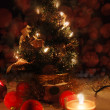 Christmas tree with lights and candles over black - Foto Stock