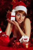 Woman santa helper with gift box — Stock Photo