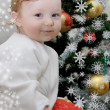 Adorable baby boy and Christmas tree — Zdjęcie stockowe