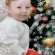 Adorable baby boy and Christmas tree — Stock Photo #12625894