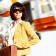Business lady with case and flying helicopter — Stock fotografie