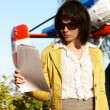 Business lady with papaers over flying helicopter - Foto Stock