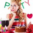 Surprised pinup girl sitting at party table with baloons — Stock Photo