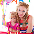 Stock Photo: Mother with her baby girl celebrating birthday