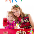 Mother and little girl at party table - Foto Stock