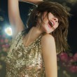 Disco girl in golden sparkling light - Foto de Stock