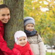 Happy mother and two children — Stock Photo
