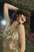 Disco girl in golden sparkling light — Stock Photo