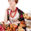 Stock Photo: Russiwomwith traditional food