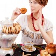Stock Photo: Russiwomeating traditional food