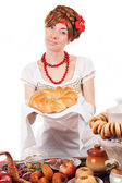 Hospitable russian woman offering traditional loaf — Stock Photo