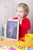 Girl showing her chalkboard drawings — Stock Photo