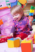 Baby girl playing in nursery — Stock Photo