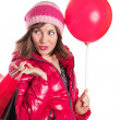 Cheerful girl in coat and hat with bag and balloon — Foto Stock