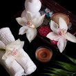 Stock Photo: White orchids and sptreatment in wooden box