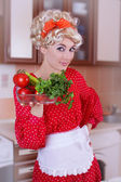 Pinup woman in red with fresh vegetables — Stock Photo