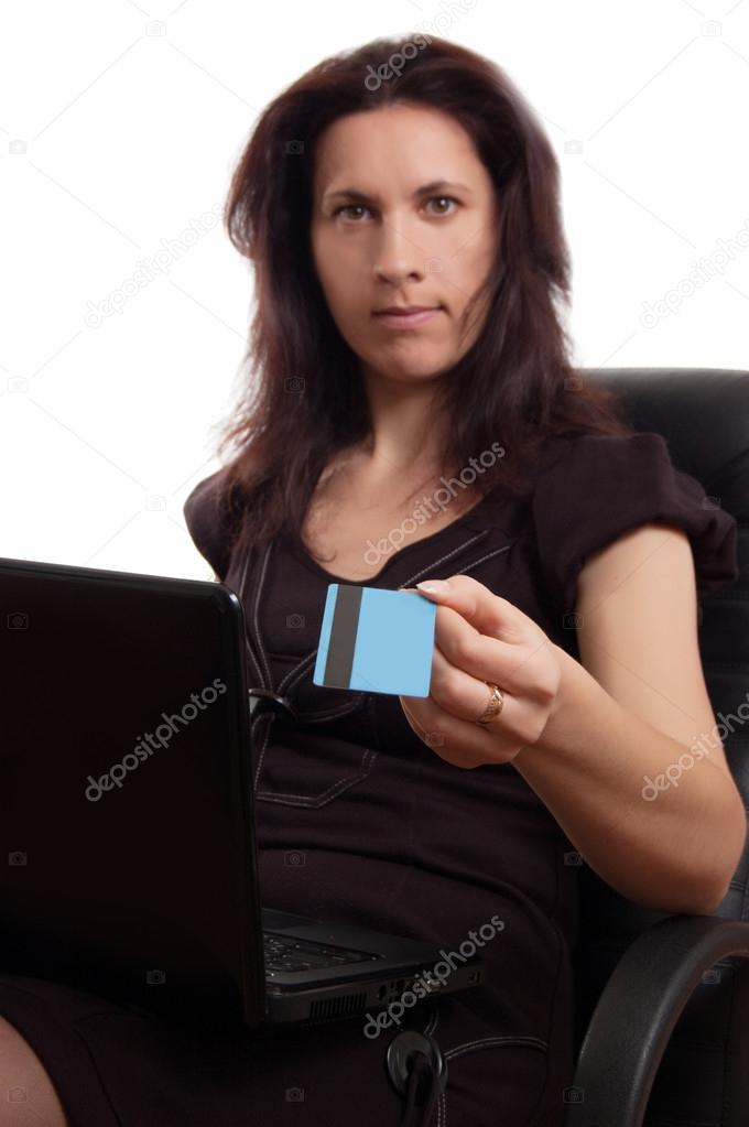 Serious woman holding credit card with laptop over white, focus on card — Stock Photo #21177223